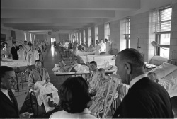 President Lyndon B. Johnson visits injured servicemen returned from Vietnam