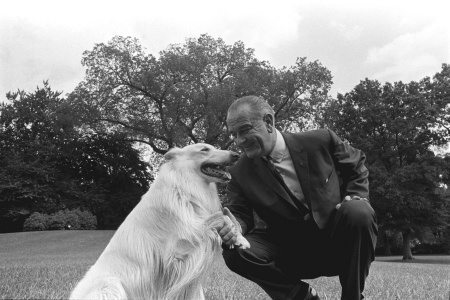 President Lyndon B. Johnson with one of his dogs
