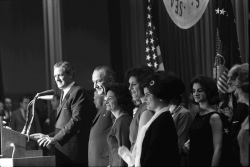 Pres. Lyndon B. Johnson and family, Texas Gov. John Connally, on stage at a celebration of the presidential election results