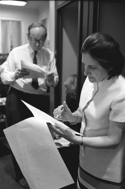 Helen Thomas looking over papers