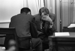 President Lyndon B. Johnson and members of his staff react to the news of Martin Luther King Jr.'s assassination
