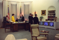 President Lyndon B. Johnson and members of his staff watch TV news reports concerning the assassination of Dr. Martin Luther King